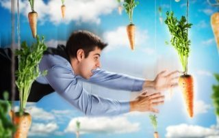 Businessman flying with carrots